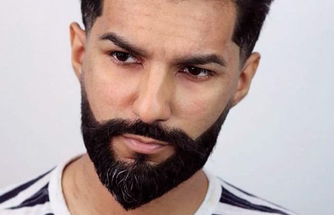 hombre con estilo de corte de barba de punta